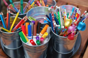 Photo of various art supplies in cans