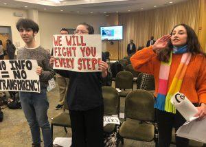 Students protesting at meeting.