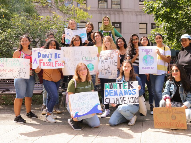 Hunter College NYPIRG students with posters at Climate Strike