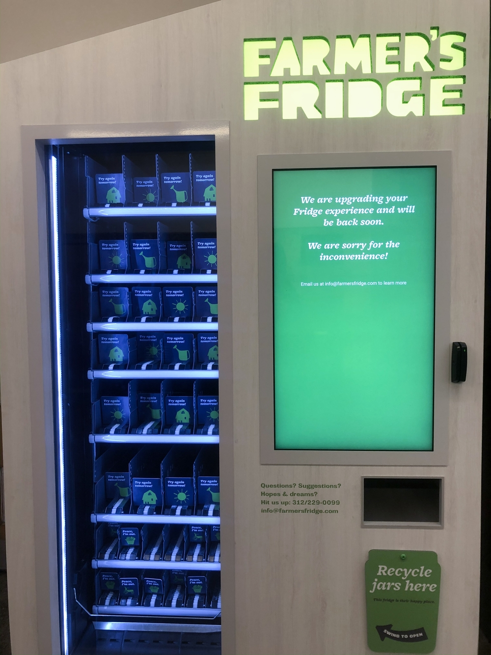 An empty Farmer's Fridge in the Brookdale dorm with a sign that says the company is upgrading the fridge.