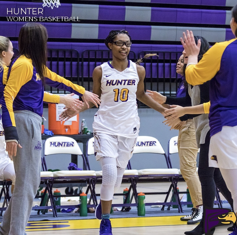 Ashley Arias high-fiving her teammates coming onto the court for her final home game