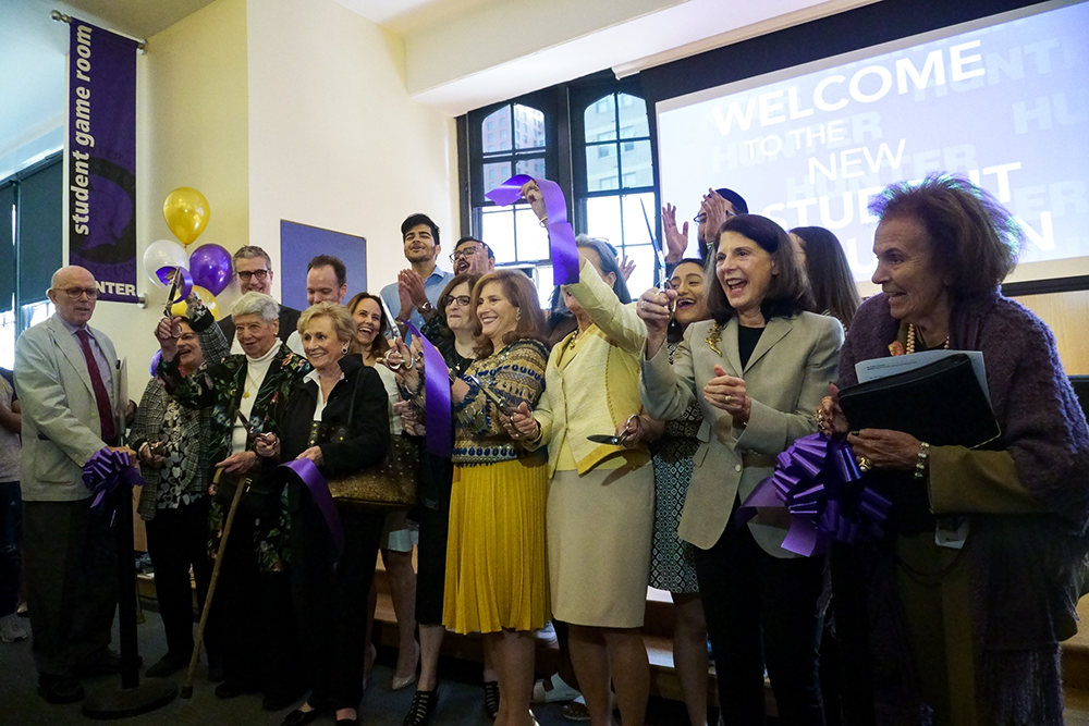 Hunter College President Jennifer Raab was joined at the ribbon-cutting ceremony by students, alumni, foundation members, and CUNY representatives to celebrate the opening of the new student union.