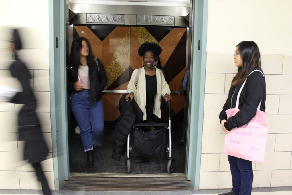 Sharice Osei, who uses a walker to get around, has to plan her commuting schedule around the limited elevator service in Hunter North.